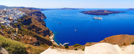 Panorama of colorful houses in Fira town, Santorini island Stock Photo