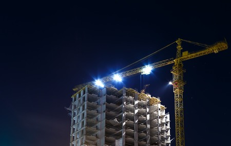 night shot of construction equipment at building site Stock Photo