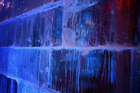 wall of ice cubes as texture or background.Blue Abstract Grunge Background.ice brick wall texture using as background.Great Wall built of ice blocks.