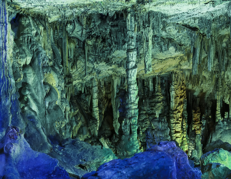 Amazing view on stalactites in colorful bright light, beautiful natural attraction, wonderful nature, touristic place,