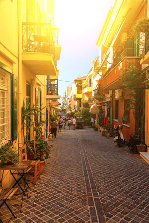 Authentic narrow colorful mediterranean street in Cretan town of Chania, island of Crete, Greece 免版税图像