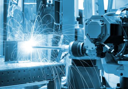 Close up torch body robot welding.
