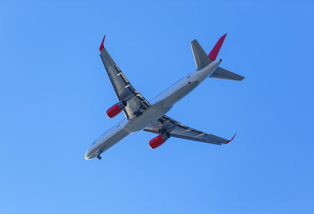 plane with landing gear against blue sky