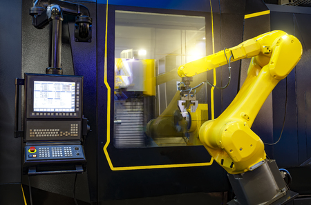 robotic hand machine tool at industrial manufacture factory working in conjunction with a numerically controlled machine Reklamní fotografie