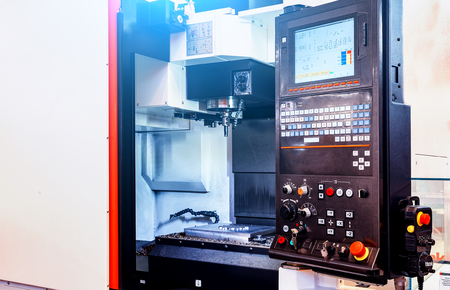 Digitally controlled modern cnc lathe with open part for metal processing in a factory