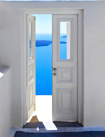 Beautiful door toe blue sea and landscape in Oia, Santorini, Greece