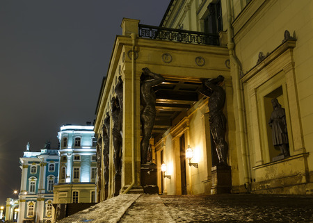 Building of New Hermitage with statues of Atlanteans in center of St.Petersburg at night