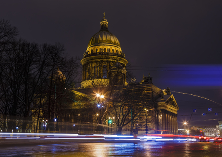 St. Isaac's Cathedral night, tracers from cars on the road in foreground. Saint-Petersburg Stock Photo