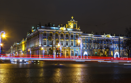 crossing road with tracers from cars against the night of the Hermitage , the winter of St. Petersburg
