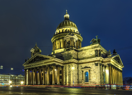St. Isaac's Cathedral at winter night, tracers from the headlights of cars in foreground ,Saint Petersburg,