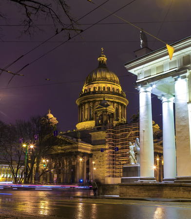 St. Isaac's Cathedral night, tracers from cars on road in the foreground. Saint-Petersburg