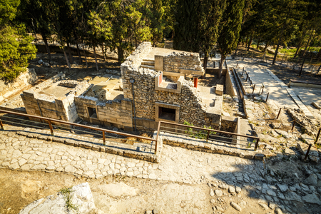 nossos palace at Crete. Knossos Palace is the largest Bronze Age archaeological site on Crete and the ceremonial and political centre of the Minoan civilizatio