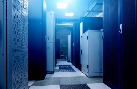Data center full of server cabinets and racks