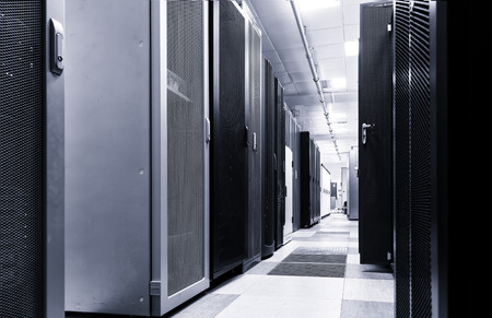 Modern server room interior in big datacenter for exchanging cyber data, cloud computing and connection, hosting services. Black and white toning