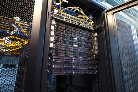 Server rack cluster hard drives storage tapes in modern internet data center room