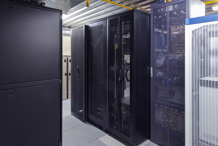 Telecommunication servers with supercomputers in datacenter. Modern interior. Data security storage center and global network connection Reklamní fotografie