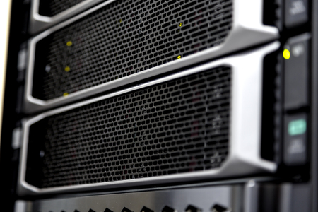 Supercomputer server racks in datacenter close up blurred frame depth of field Imagens