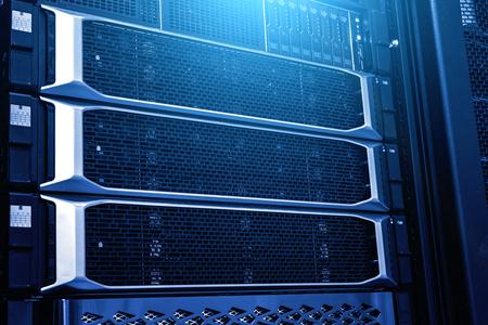Modern mainframe storage in data center close up under neon blue toning