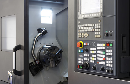 Control panel of CNC milling machine. Computer controlled lathe. Many kind switch button and turns dial with monitor. Industrial equipment at factory
