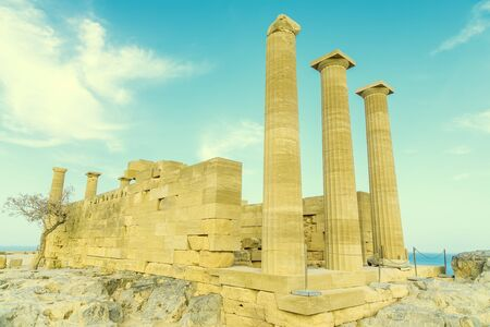 Doric temple of Athena Lindia on Acropolis of Lindos Rhodes, Greece. Front view of columns and walls.