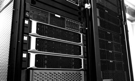 Blade server in rack cluster hard drives storage in internet data center room black and white Banque d'images