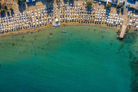 Tropical beach with colorful umbrellas - Top down aerial view. Lindos , Rhodes, Greece Imagens