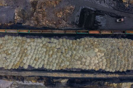 composition unloads crushed stone on the territory of the plant, polluting environment, the view from the drone