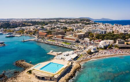 Aerial birds eye view drone photo of Rhodes city island, Dodecanese, Greece. Panorama with Mandraki port, lagoon and clear blue water.