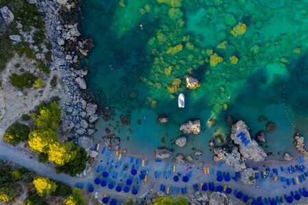 Anthony Quinn Bay. The most beautiful beach at Rhodes island. birds eye view from above, rocks, clear sea, beach and Bay with people 스톡 콘텐츠