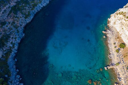 beautiful Bay of Greek island view from drone with birds eye view. Sea, rocks, vegetation and turquoise sea