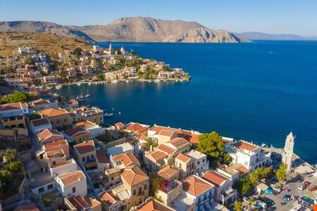 Greek island with colorful houses and Bay with Marina and boats in the Parking lot, Greece Europe 스톡 콘텐츠