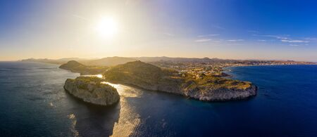 Aerial birds eye view drone photo Anthony Quinn and Ladiko bay on Rhodes island, Dodecanese, Greece. Panorama with nice lagoon and clear blue water. Famous tourist destination in South Europe 스톡 콘텐츠