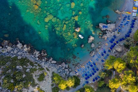 picturesque Bay of the sea with beach rocks and stones, clear turquoise water, view from the drone