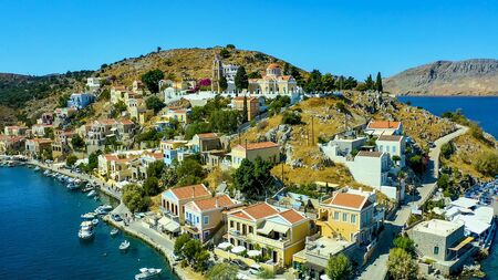 Simi island Greece view from the drone on the colorful houses and the Bay of the sea with ships