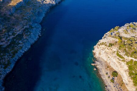 Aerial birds eye view photo taken by drone of famous beach of Anthony Quinn with clear water rocky seascape, Rhodes island, Greece