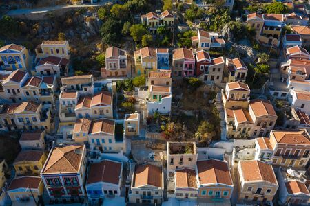 Symi, Dodecanese island, Greece. Beautiful bay with colorful houses on hillside of the island of Symi