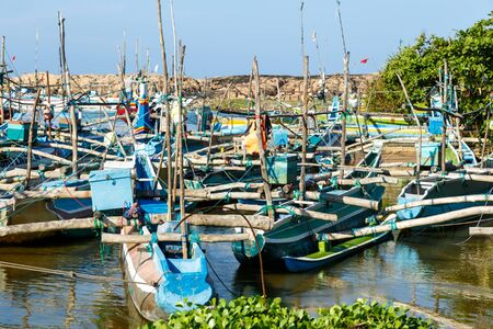 Fishing boats stand in Harbour, fish market in Sri Lanka Stock Photo