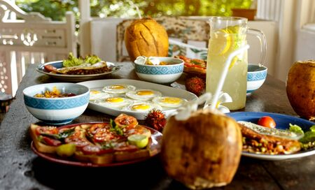 simple healthy food on an old wooden table, serving with simple dishes, natural lemonade