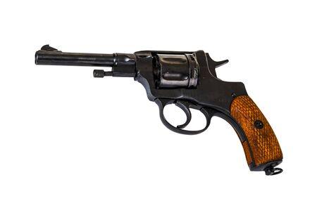 vintage old black shiny revolver gun isolated on a white background Foto de archivo