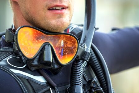 mask with snorkel suit to dive face closeup of a young diver, the concept of a hobby of diving