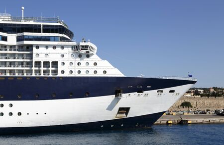 large blue and white cruise ship in the port of the historical city, side view, Rhodes island, Greece.