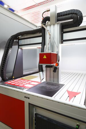 CNC Laser cutting of metal, modern industrial technology. Small depth of field. Warning - authentic shooting in challenging conditions Banco de Imagens