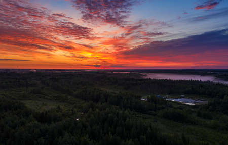 panorama of dawn in the Northern region of Russia, Khanty-Mansiysk, white nights with a stunning orange dawn and clouds