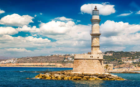 Photo of iconic old Venetian lighthouse in old harbour of Chania. Crete island, Greece.