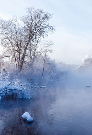 morning winter frosty landscape with fog and forest on the river bank, Russia, Ural, January 版權商用圖片