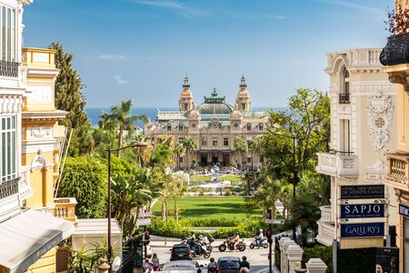 Monaco, Monte-Carlo, 02 October 2019: The main sight of the principality casino surrounded with the green trees, the updated facade, through the fountain, hotel the Paris, sunny day Éditoriale