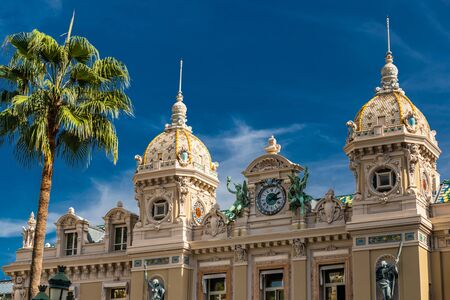 Monaco, Monte-Carlo, 02 October 2019: The main sight of the principality casino surrounded with the green trees, the updated facade, sunny day