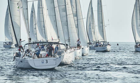 Sailboats compete in a sailing regatta, the team turns off the boat, reflection is on water, white sails, boat number aft boats, Strained competition, Croatia, Mediterranean Sea, 18 September 2019 Sajtókép