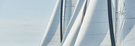 Spinnaker and sail of white color, Sailboats compete in a sailing regatta at sunset, sailing race Zdjęcie Seryjne