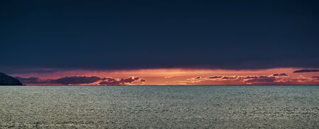 The dramatic sunset, the orange sky, the quiet sea, solar path, seagull